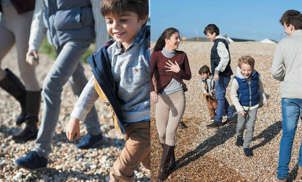 lifestyle photography of kids ona beach in autumn playing